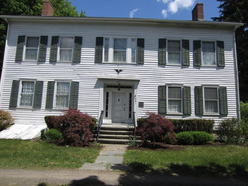 Note the symmetry of the facade, the hip roof, and the Federal Eagle, These architectural aspects indicate that the house was built in the Federal style, a common theme in the late 1700s and early 1800s that communicated not only stylistic ideas, but