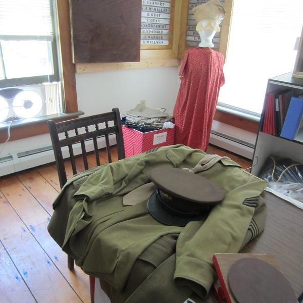 """The Knox Historical Society provides several activities for kids, including historical dress up, drumming activities, and the challenge to crawl through a replica of the small space in Knox cave called the """"gun barrel"""""""