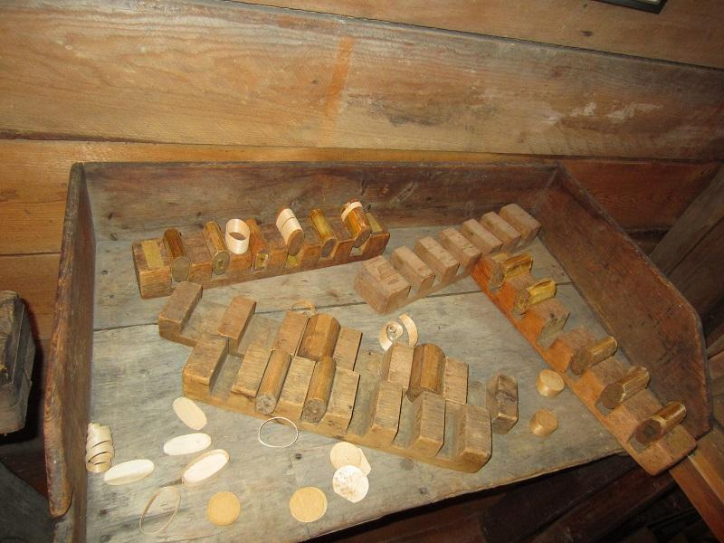 """The Pill Box industry was a """"cottage"""" industry. Women and children would wrap shavings of basswood around these molds called """"rollers"""" and glue them together with a homemade glue made on the stove with melted horse hooves. Then, t"""